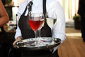 Waiter carrying wine glasses Stock Photography