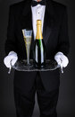 Waiter with Champagne on Tray Stock Image