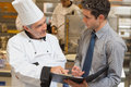 Waiter and chef discussing the menu Royalty Free Stock Photo