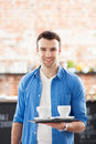 Waiter holding cups coffee cafe Stock Image