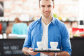 Waiter holding cups coffee cafe Royalty Free Stock Images