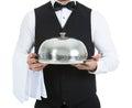 Waiter holding domed tray Royalty Free Stock Photo