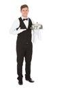 Waiter holding empty silver tray Royalty Free Stock Photo