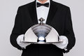 Waiter holding a silver cloche Stock Photo