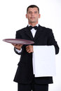 Waiter holding tray Stock Photo