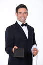Waiter with a menu handing out Stock Photos