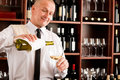Waiter serve wine glass happy restaurant Royalty Free Stock Photography