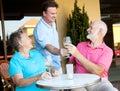 Waiter Serves the Wine Royalty Free Stock Photo