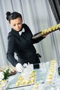 Waiter serving catering table Royalty Free Stock Photo
