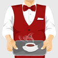 Waiter serving cup of coffee on silver tray Royalty Free Stock Photo
