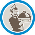 Waiter serving food on platter retro illustration of a holding plate of facing front set inside circle isolated background done in Royalty Free Stock Photos