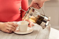 Waiter serving lady with hot beverage Royalty Free Stock Photo