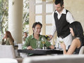 Waiter serving wine to couple young at outdoor restaurant Royalty Free Stock Photography