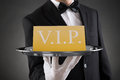 Waiter Showing Vip Text On Banner Royalty Free Stock Photo
