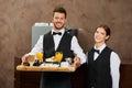 Waiter staff serving breakfast team in a hotel restaurant Royalty Free Stock Photos