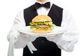 Waiter torso with hamburger on plate Royalty Free Stock Photo