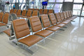 Waiting area in the airport gate with leather seats Stock Photography