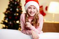 Waiting for christmas portrait of a cute girl on a eve being excited about celebration Stock Image
