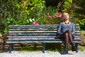 Waiting for love. Young girl in love on the bench. Royalty Free Stock Photo