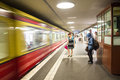 Waiting in the metro station train moving fast front of of a group of people for next one Royalty Free Stock Images
