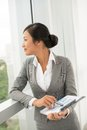 Waiting for a miracle profile of businesswoman looking in the window Royalty Free Stock Photo