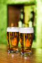 Waiting for you close up of man holding glass with beer while standing at the bar counter Royalty Free Stock Photo