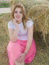 Waiting for you in the haystack beautiful young redhead to come have a seat by her on Royalty Free Stock Photography