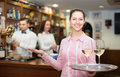 Waitress and barmen working happy brunette in modern bar Royalty Free Stock Images