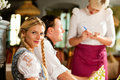Waitress in Bavarian restaurant taking orders Royalty Free Stock Photos