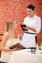Waitress with customer a female Royalty Free Stock Photo