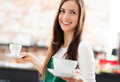Waitress holding cups coffee cafe Stock Images