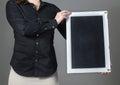 Waitress holding vertical chalkboard Royalty Free Stock Photo