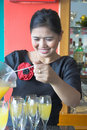 Waitress making drink Stock Images
