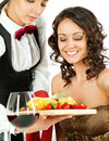 Waitress offering fruits to customer Royalty Free Stock Photography