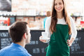 Waitress serving men coffee cafe Stock Photography