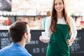 Waitress serving man coffee Royalty Free Stock Photo