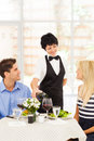 Waitress serving wine Stock Photo