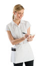 Waitress smiling while writing on order pad young against white background Stock Image