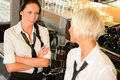 Waitresses talking gossiping in break cafe women Royalty Free Stock Photo