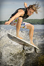Wake surfing canadian chris hau competes in the st annual calabogie surf championship held on calabogie lake ontario canada on Royalty Free Stock Photo