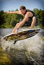 Wake surfing drew danielo competes in the st annual calabogie surf championship held on calabogie lake ontario canada on july drew Royalty Free Stock Images