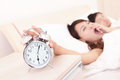 Wake up tired couple touch the alarm clock while they are sleeping in bed asian family Stock Photo