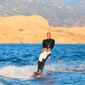 Wakeboarder en puesta del sol Imagen de archivo libre de regalías