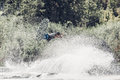 Wakeboarder jump over the lake. Tonned photo Royalty Free Stock Photo