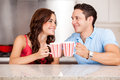 Waking up with coffee handsome young men and his girlfriend drinking some together in the morning Royalty Free Stock Photo