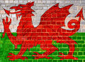 Wales flag on a brick wall background
