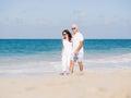 Walk along the waves couple walking on beach Stock Photography