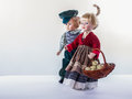 Walk of couple dolls with basket full eggs.