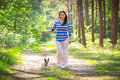 Walk with the dog beautiful brunette on Stock Photography