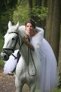 Walk with the favourite young beautiful woman on a white horse Stock Photo